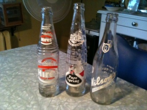 "Vintage soft-drink (""pop,"" if you must) bottles, all found last weekend in Stratford: Hires root beer, Pure Spring ginger ale, and Wilson's ginger ale. Where are they now? But at least the bottles will live on in some nook at the Manse."