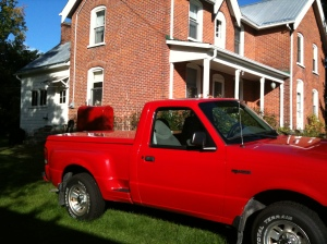 My real favourite colour, very much in evidence at the Manse: bright red truck (Raymond's) and, in the background, bright-red (newly painted by Raymond) oil tank. That's my colour!