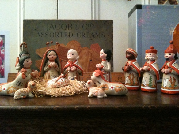 This lovely little crèche scene comes from Guatemala originally. We bought it at a funky collectibles store in Stonington, Maine, where the collectibles are mostly things the owner has picked up in her own travels. It's atop a bookshelf in the Manse's living room.