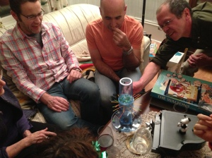 My brother John (left), my brother Ken (centre) and my brother-in-law Greg strategizing over a rousing game of Ker-Plunk (I am not making this up) in the Manse living room prior to Christmas dinner.