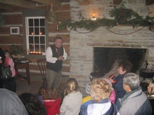 Storytelling by the fireplace at a previous Christmas event at O'Hara Mill. That's our friend Grant Ketcheson telling a tale. (Photo from ohara-mill.org)