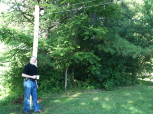 Raymond with our new clothesline, put in by our friend and neighbour Ed.