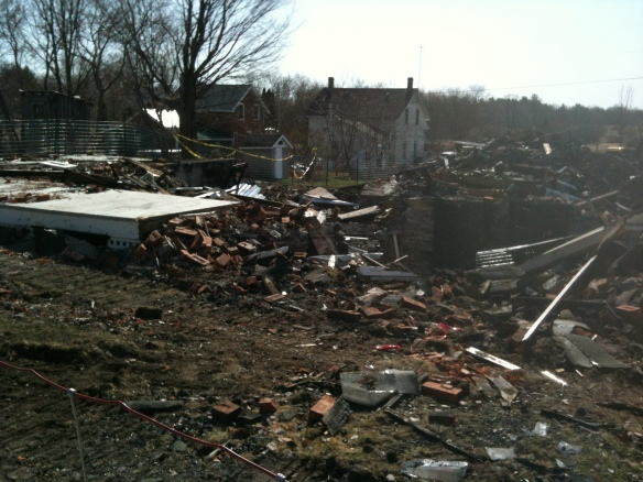 "The debris from the fire in March 2012 that burned what we old-timers call ""the Green house"" to the ground."
