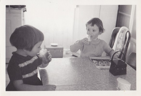 My sister, Melanie (right) and me at the table in the Manse kitchen sometime in the mid-1960s – around the time that I started to contract all the famous childhood diseases. Don't you just love that square black vinyl purse? That was my pride and joy. (Photo by my grandfather, J.A.S. Keay)