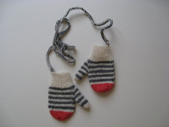 I don't know about you, but I could use a pair of these, to keep from losing them. This particular very cute pair of mittens (for children) are hand-knitted and available at Etsy.com, here.