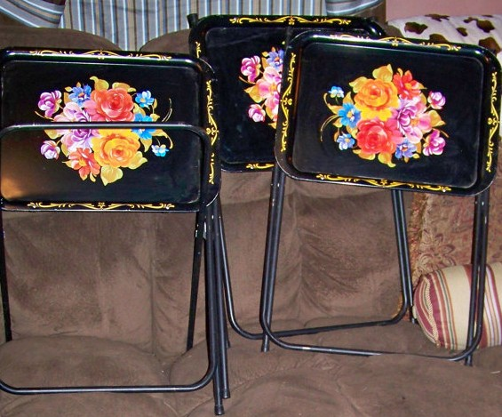 I bet these take you back if you are of a certain age. Remember when every household had a set of TV trays? These, for sale here at Etsy, are remarkably like a set I fondly remember being ensconced at the home of my maternal grandparents, the Keays.