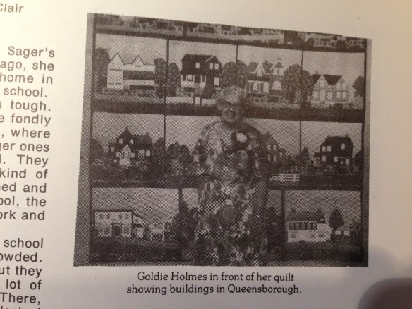 "A photo of Goldie Holmes in front of her ""Queensborough quilt"" that appears in the book Times to Remember in Elzevir Township. Look closely and you'll see that this is not the same quilt as the one that's at the Tweed and Area Heritage Centre."