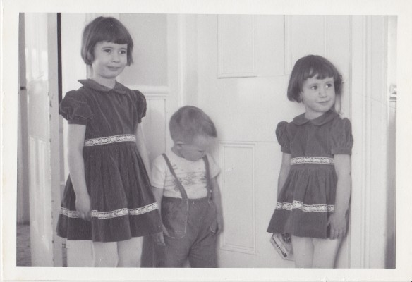 This is me (at left) and my younger siblings John and Melanie at the Manse in 1966 – the era when we were at the prime age for enjoying an early-Easter-morning Easter-egg hunt. My youngest sibling, Ken, wasn't yet born; when he came along, he just added to the Easter-morning ruckus. (Photo by my grandfather, J.A.S. Keay)