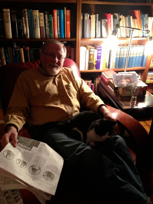 A relaxing evening for Raymond with his newspaper, his books and (in his lap) Sieste the cat. Can you guess which house – Queensborough or Montreal – this photo was taken in?