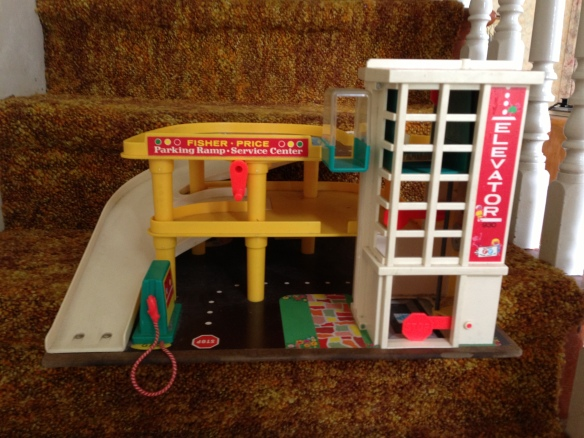 The Fisher-Price Garage, late-1960s edition. Best toy ever. I have been seeking one out for years, and was thrilled to find one at a yard sale this weekend. Now if I just had the little cars and drivers…