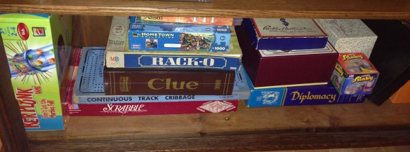 The vintage-games shelf at the Manse already has a very old Monopoly game, Clue, Ker-Plunk, Cribbage, Scrabble, Diplomacy and Rack-O. Stock Ticker would have been a perfect addition.