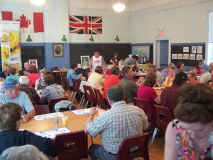 I like this photo because it not only shows the excellent turnout for the pancake breakfast, but gives you a good sense of the interior of the historic former one-room schoolhouse. (Photo by Elaine Kapusta)