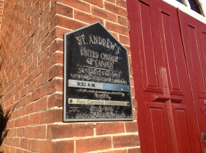 A healthy sign of life at St. Andrew's United: our excellent minister's name is now on the sign at the front of our historic little chuch building!