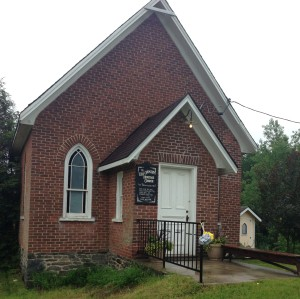The Old Ormsby Heritage Church – and, in the rear, its church-styled outhouse! (A delightful touch by the Pattinsons.)