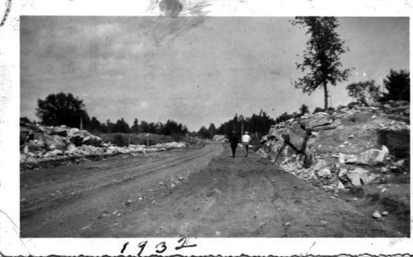 Another view of Highway 7 under construction, this one showing Peter Forbes and Art Robinson, who lived in that part of Elzevir Township. (Photo courtesy of Keith Millard)