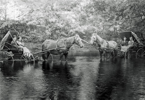 Historic photo from Elzevir Township, of unknown members of the Kleinsteuber family, probably in the Skootamatta River.