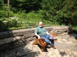 Raymond on Aunt Ada's bench in Pauline Weber's garden on the Tweed Garden Tour