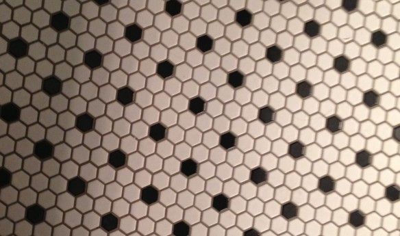 hexagonal black-and-white bathroom floor tiles