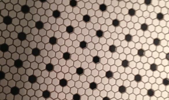 hexagonal black-and-white bathroom floor tiles