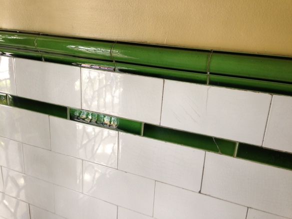 beautiful vintage green and white ceramic tile