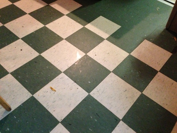 green and white square linoleum tiles