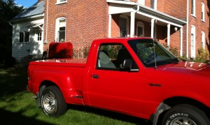 Red truck and oil tank