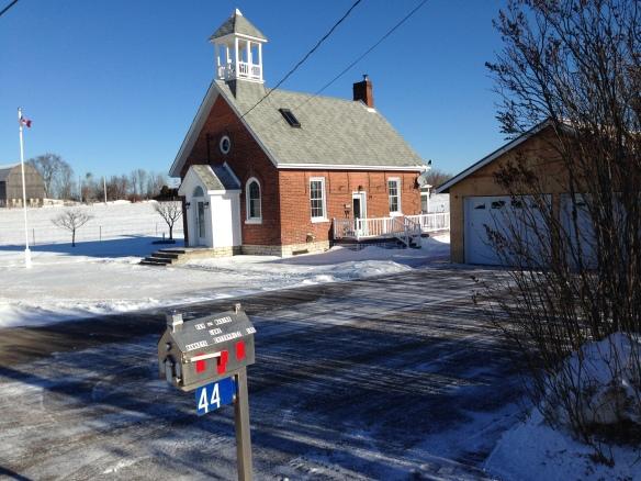 Schoolhouse mailbox, Moore's Corners