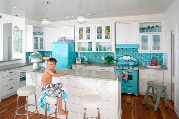 Turquoise and white kitchen with Northstar appliances that you see here.
