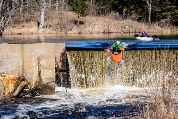Kayakers going over the dam by Dave deLang