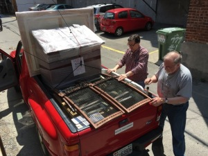 Bill and Raymond packing up the red truck
