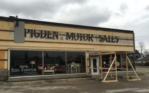 Pigden Motor Sales sign at Bush Furniture