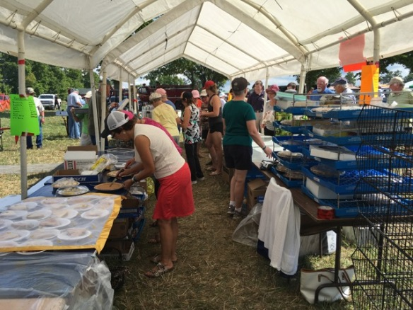 Serving food at the Three United Churches tent
