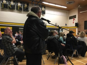 Tom Deline speaks at public meeting