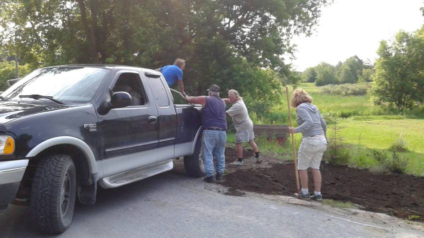 Johnny and others spreading topsoil