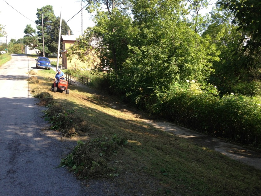 Johnny mowing along Bosley Road, September 2013