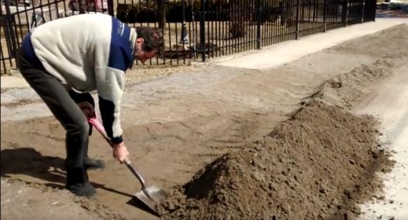 Jos shovelling sand