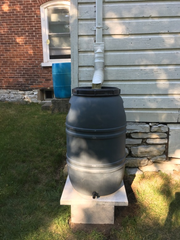 Old and new rain-barrel setups