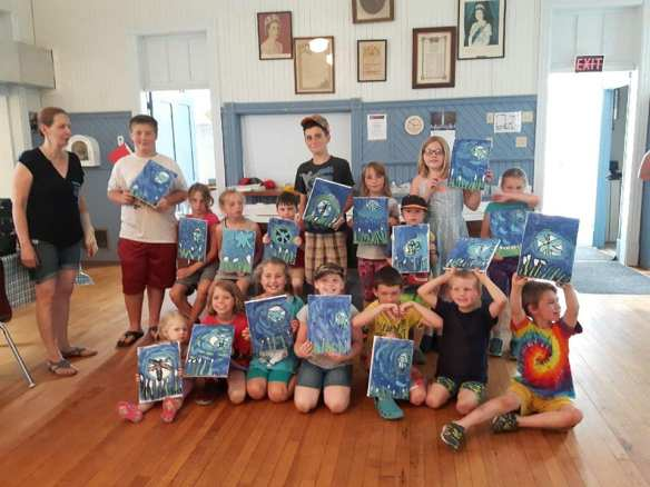 The kids with their paintings
